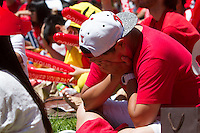 Los Angeles, CA -  Sunday, June 22, 2014: A South Korea fan reacts to an Algeria goal. Thousands of Koreans watched the South Korea vs. Algeria first round match on the  front lawn of Wilshire Park Place.