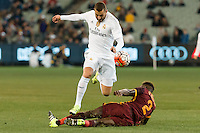 Melbourne, 18 July 2015 - Karim Benzema of Real Madrid skips over Mapou Yanga-Mbiwa of AS Roma in game one of the International Champions Cup match at the Melbourne Cricket Ground, Australia. Roma def Real Madrid 7-6 Penalties. Photo Sydney Low/AsteriskImages.com