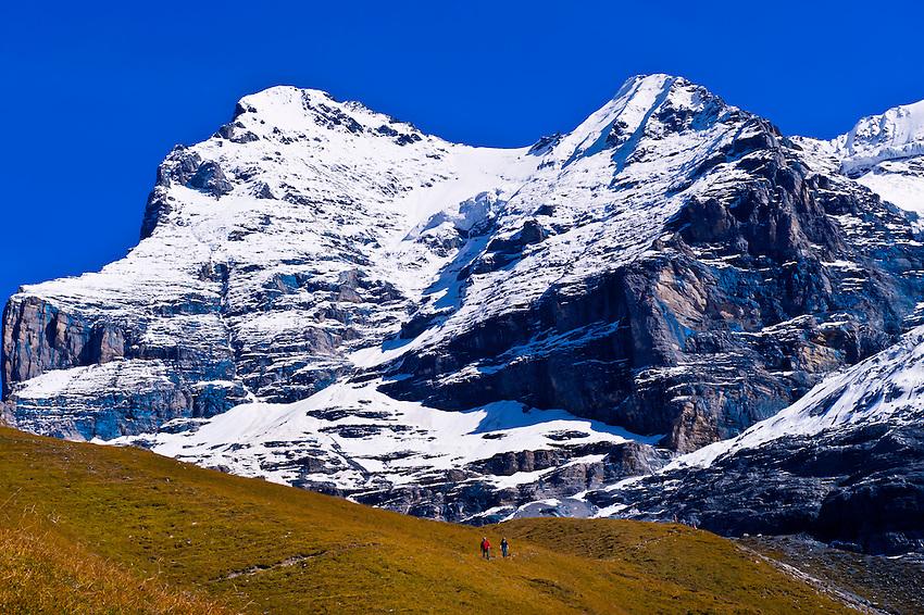 Hiking in the Swiss Alps from Eigergletscher down to Wengernalp (Eigergletscher in background), Kleine Scheidegg, Canton Bern, Switzerland