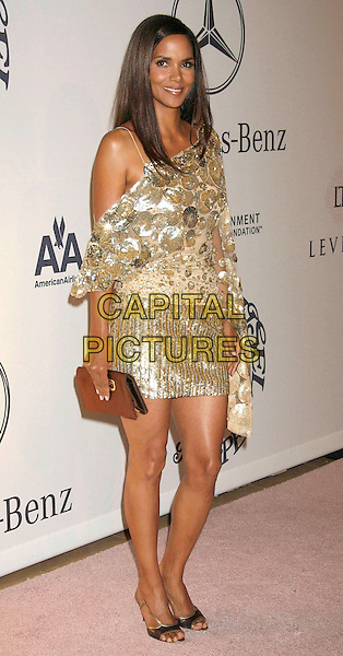 HALLE BERRY.17th Annual Carousel of Hope Ball held at the Beverly Hilton Hotel, Beverly Hills, California, USA, .28 October 2006..full length gold dress top skirt beaded sheer long sleeve one shoulder bag shoes.Ref: ADM/RE.www.capitalpictures.com.sales@capitalpictures.com.©Russ Elliot/AdMedia/Capital Pictures.