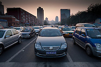 Daytime landscape view of automobile traffic at the intersection of Chao Yang Bei Lu and Dong San Huan Zhong Lu in Cháoyáng Q? in Beijing.  © LAN