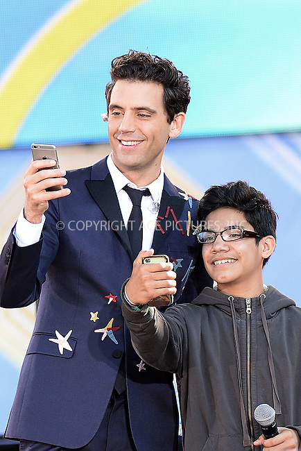 WWW.ACEPIXS.COM<br /> July 3, 2015 New York City<br /> <br /> Mika and Ozzie performing on Good Morning America's summer concert series in Central Park on July 3, 2015 in New York City.<br /> <br /> Credit: Kristin Callahan/ACE Pictures<br /> <br /> Tel: 646 769 0430<br /> e-mail: info@acepixs.com<br /> web: http://www.acepixs.com