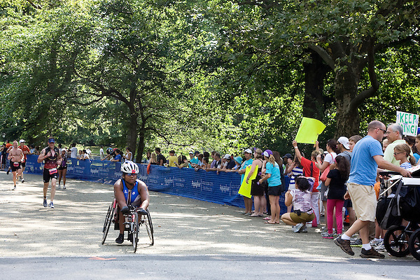 Minda competes in the running leg of the Aquaphor New York City Triathlon via a racing wheelchair in New York on July 8, 2012.