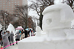 February 4, 2019, Sapporo, Japan - Visitors admire a snow sculpture of TV character Chikochan displayed at the 70th annual Sapporo Snow Festival in Sapporo in Japan's nortern island of Hokkaido on Monday, February 4, 2019. The week-long snow festival started at the Odori Park in central Sapporo through February 11 and over 2.5 million people are expecting to visit the festival.   (Photo by Yoshio Tsunoda/AFLO)