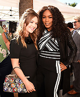 HOLLYWOOD, CALIFORNIA - DECEMBER 4: (L-R) Billie Lourd and Angela Bassett attends  ceremony honoring Ryan Murphy with a star on The Hollywood Walk of Fame on December 4, 2018 in Hollywood, California. (Photo by Frank Micelotta/Fox/PictureGroup)