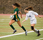 MIDDLETOWN, CT-111817JS22- Holy Cross' Adalisse Padilla (10) runs the ball past Old Lyme's Britney DeRoehn (10) during their Class S state final game Saturday at Middletown High School.<br /> Jim Shannon Republican-American