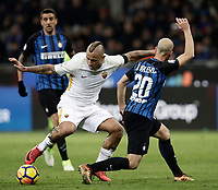 Calcio, Serie A: Inter - Roma, Milano, stadio Giuseppe Meazza (San Siro), 21 gennaio 2018.<br /> Roma's Radja Nainggolan (l) in action with Inter's Borja Valero (r) during the Italian Serie A football match between Inter Milan and AS Roma at Giuseppe Meazza (San Siro) stadium, January 21, 2018.<br /> UPDATE IMAGES PRESS/Isabella Bonotto