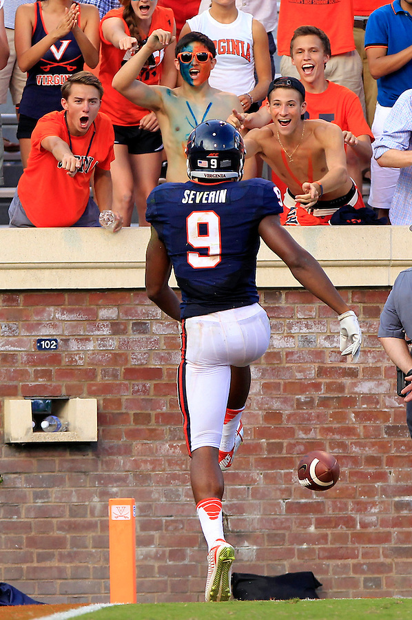 Fans react to a fourth quarter touchdown by Virginia wide receiver Canaan Severin (9) Saturday Sept. 6, 2014 at Scott Stadium in Charlottesville, VA. Virginia defeated Richmond 45-13. Photo/Andrew Shurtleff