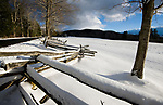 WINSTED, CT-122517JS12---Freshly fallen snow sites on a split-rail fence and covers a field on Mountain Road in Norfolk on Monday. A fast moving snow storm dropped around three inches of snow throughout the northwest corner of the state. <br /> Jim Shannon Republican-American