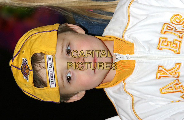 BROOKLYN BECKHAM.Scooby Doo 2 premiere at Warner Village, Islington.26 March 2004.headshot, portrait, yellow los angeles lakers cap hat.www.capitalpictures.com.sales@capitalpictures.com.©Capital Pictures