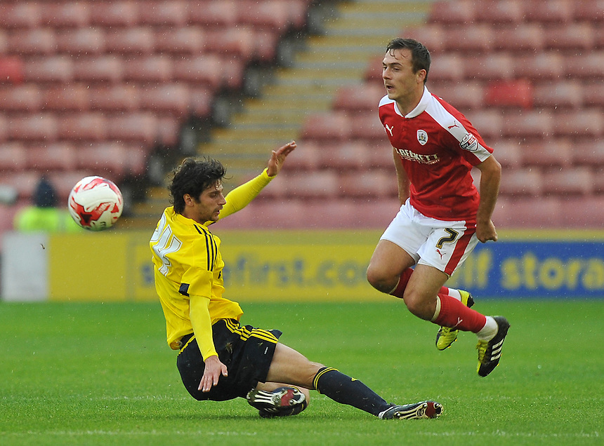 Barnsley's Josh Scowen is tackled by Middlesbrough's Diego Fabbrini<br /> <br /> Photographer Dave Howarth/CameraSport<br /> <br /> Football - Football Friendly - Barnsley v Middlesbrough - Wednesday 29th July 2015 - Oakwell - Barnsley<br /> <br /> &copy; CameraSport - 43 Linden Ave. Countesthorpe. Leicester. England. LE8 5PG - Tel: +44 (0) 116 277 4147 - admin@camerasport.com - www.camerasport.com