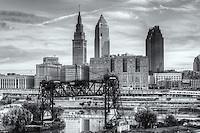 The Terminal Tower and Key Tower, lit by early morning light, dominate the skyline of Cleveland, Ohio.  The Terminal Tower was the 4th tallest building in the world when built in 1930 and remained the tallest in Cleveland until the completion of the Key Tower (then Society Tower) in 1991.  This view includes the abandoned Eagle Avenue Bridge, a vertical-lift bridge spanning the Cuyahoga River.