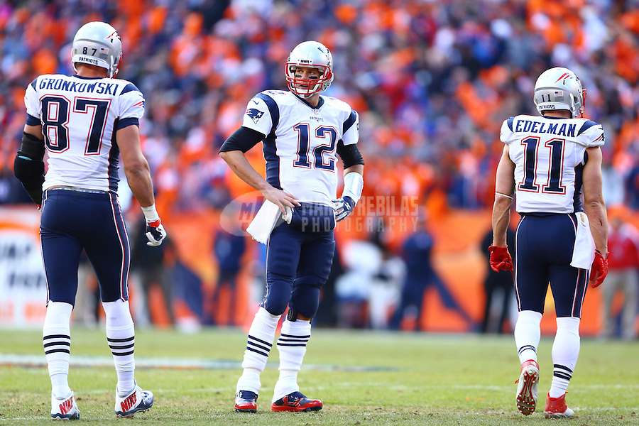 Jan 24, 2016; Denver, CO, USA; New England Patriots quarterback Tom Brady (12) with tight end Rob Gronkowski (87) and wide receiver Julian Edelman (11) against the Denver Broncos in the AFC Championship football game at Sports Authority Field at Mile High. Mandatory Credit: Mark J. Rebilas-USA TODAY Sports