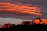 Clouds at sunrise over mountain range, Torres del Paine National Park, Patagonia, Chile