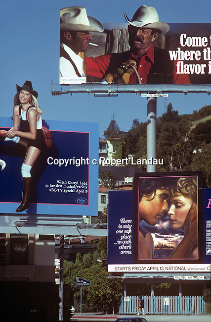 Billboards compete for attention on the Sunset Strip including Cheyl Ladd and Marlboro cowboys circa 1979