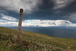 Fence and Storm Clouds over Isle of Skye (North of Storr Looking to Rona and Loch Torridon), Scotland