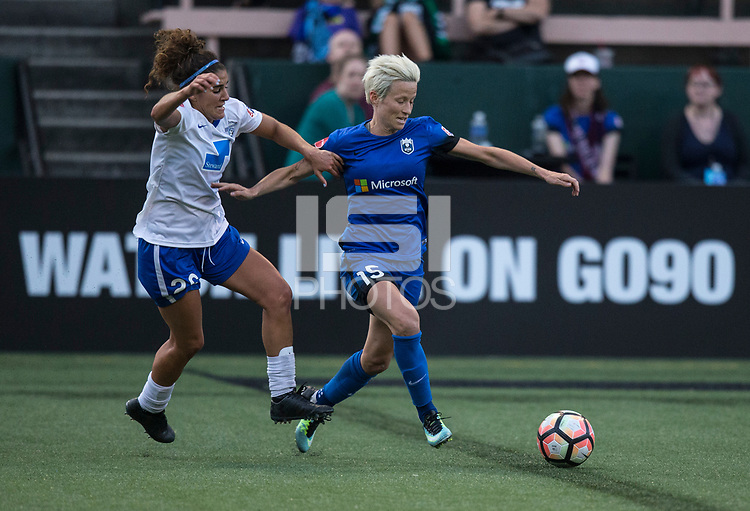 Seattle, WA - Saturday July 15, 2017: Angela Salem, Megan Rapinoe during a regular season National Women's Soccer League (NWSL) match between the Seattle Reign FC and the Boston Breakers at Memorial Stadium.