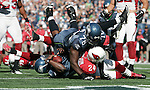 Seattle Seahawks Tarvaris Jackson dives into the end zone for a touchdown after a 11-yard run against the Arizona Cardinals at CenturyLink Field in Seattle, Washington September 25, 2011.  The Seahawks beat the Cardinals 13-10.  ©2011 Jim Bryant Photo. All Rights Reserved.