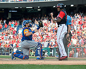 New York Mets catcher Travis d'Arnaud (18) shows home plate umpire Andy Fletcher (49), who is partially obscured by Washington Nationals pinch runner Edwin Jackson (40) that he held on to the ball as Fletcher calls Jackson out to end the first game of a double-header against the Washington Nationals at Nationals Park in Washington, D.C. on Sunday, August 27, 2017.  The Mets held on to win the game 6 - 5.<br /> Credit: Ron Sachs / CNP<br /> (RESTRICTION: NO New York or New Jersey Newspapers or newspapers within a 75 mile radius of New York City)