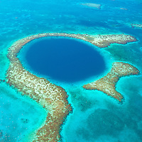 The Blue Hole, Blue Hole National Monument, Belize,  Caribbean Sea, Meso-American Reef, Lighthouse Reef Atoll, 400 foot hole in reef surface from ice age, Largest reef in Western Hemisphere. Aerial view