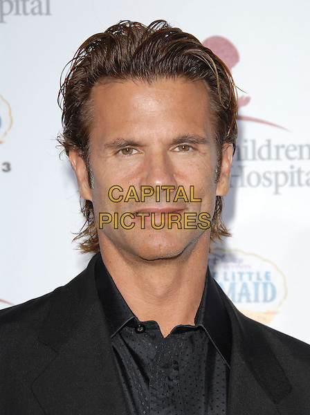 LORENZO LLAMAS.Attends Runway for Life, Benefiting St. Jude Children's Research Hospital held at The Beverly Hilton Hotel in Beverly Hills, California, USA, September 15th 2006..portrait headshot.Ref: DVS.www.capitalpictures.com.sales@capitalpictures.com.©Debbie VanStory/Capital Pictures