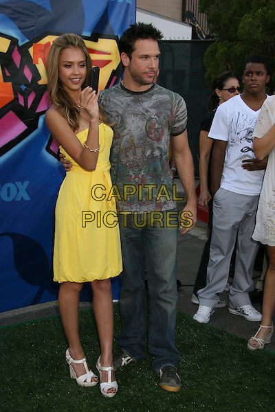 JESSICA ALBA & DANE COOK.2007 Teen Choice Awards held at the Gibson Amphitheater, Universal City, California, USA..August 26th, 2007.full length yellow strapless dress white shoes platform wedges sash cream hand funny jeans denim grey gray print t tee shirt .CAP/ADM/RE.©Russ Elliot/AdMedia/Capital Pictures