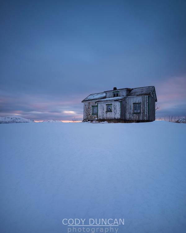 Abandoned building in snow covered landscape, Vestvågøy, Lofoten Islands, Norway