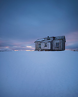Abandoned building in snow covered landscape, Vestvågøy, Lofoten Islands, Norway