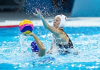 30 JUL 2012 - LONDON, GBR - Beckie Kershaw (GBR) of Great Britain (right) blocks Ekaterina Prokofyeva (RUS) of Russia (left) during their women's London 2012 Olympic Games water polo qualification match in the Olympic Park Water Polo Arena in Stratford, London, Great Britain (PHOTO (C) 2012 NIGEL FARROW)