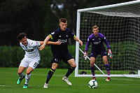 Monday 20th August 2018<br /> Pictured: Swansea City's Liam Cullen vies for possession with Derby County's Calum Macdonald<br /> Re: Swansea City U23 v Derby County U23 Premier League 2 match at the Landore Training facility, Swansea, Wales, UK