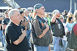 "Bikers during the playing of ""Taps"" before the start of the 2014 911 Memorial Bike Ride in Montgomery, PA."
