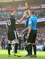 Burnley's Ashley Barnes is shown a yellow card by Referee Kevin Friend<br /> <br /> Photographer David Shipman/CameraSport<br /> <br /> The Premier League - Arsenal v Burnley - Saturday 22nd December 2018 - The Emirates - London<br /> <br /> World Copyright © 2018 CameraSport. All rights reserved. 43 Linden Ave. Countesthorpe. Leicester. England. LE8 5PG - Tel: +44 (0) 116 277 4147 - admin@camerasport.com - www.camerasport.com