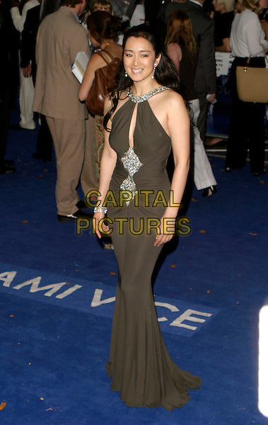 "GONG LI.""Miami Vice"" UK film premiere, Odeon Leicester Square, London UK..July 27th, 2006.Ref: AH.full length green brown halterneck dress .www.capitalpictures.com.sales@capitalpictures.com.©Adam Houghton/Capital Pictures."