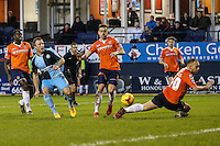 Garry Thompson of Wycombe Wanderers (2nd left) shoots during the Sky Bet League 2 match between Luton Town and Wycombe Wanderers at Kenilworth Road, Luton, England on 26 December 2015. Photo by David Horn.