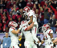 NWA Media/Michael Woods --12/29/2014-- w @NWAMICHAELW...University of Arkansas receiver Demetrius Wilson celebrates with his teammates after making a touchdown catch in the 2nd quarter of the Texas Bowl Monday night against the University if Texas at  NRG Stadium in Houston.