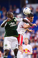 Sebastien Le Toux (9) of the New York Red Bulls goes up for a header with Hanyer Mosquera (33) of the Portland Timbers. The New York Red Bulls  defeated the Portland Timbers 3-2 during a Major League Soccer (MLS) match at Red Bull Arena in Harrison, NJ, on August 19, 2012.