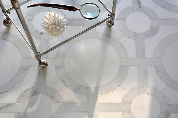 Cirque, a handmade mosaic shown in honed Thassos and polished Calacatta Tia, is by Sara Baldwin for New Ravenna.<br /> <br /> For pricing samples and design help, click here: http://www.newravenna.com/showrooms/
