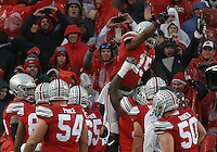 Ohio State Buckeyes running back Ezekiel Elliott (15) is held up by the team after scoring a touchdown in the first half of their game at Ohio Stadium in Columbus, Ohioan November 21, 2015. (Columbus Dispatch photo by Brooke LaValley)