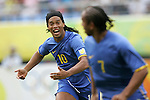 10 August 2008: Ronaldinho (BRA) (10) races to congratulate teammate Anderson (BRA) (7) on his first half goal.  The men's Olympic soccer team of Brazil defeated the men's Olympic soccer team of New Zealand 5-0 at Shenyang Olympic Sports Center Wulihe Stadium in Shenyang, China in a Group C round-robin match in the Men's Olympic Football competition.
