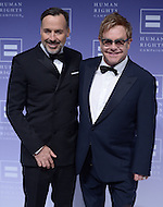 Washington, DC - October 25, 2014: Sir Elton John (r) and his partner, David Furnish, pose on the red carpet at the Human Rights Campaign's National Dinner, October 25, 2014, at the Walter E. Washington Convention Center in the District of Columbia.   (Photo by Don Baxter/Media Images International)