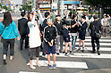 Tokyo, Japan - People on the street take pictures of the annual solar eclipse in Tokyo on Monday 21st May. It was the first time in 173 years such an eclipse was visible from the Japanese capital.