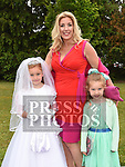 Lucy Bannon who received first holy communion in St Joseph's church Mell pictured with her mam Shiofra and sister Cliodhna. Photo:Colin Bell/pressphotos.ie