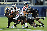 24 September 2011:  FIU linebacker Winston Fraser (34) and safety Jonathan Cyprien (7) combine to tackle ULL running back Aaron Spikes (20) in the second quarter as the University of Louisiana-Lafayette Ragin Cajuns defeated the FIU Golden Panthers, 36-31, at FIU Stadium in Miami, Florida.