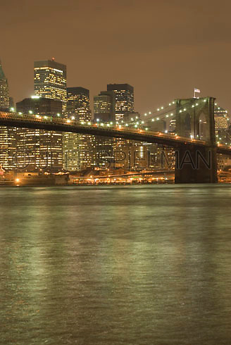 THIS IMAGE I S AVAILABLE EXCLUSIVELY FROM GETTY IMAGES.....Please search for image #200524229-001 on www.gettyimages.com.....Brooklyn Bridge, East River and Lower Manhattan Skyline on an Overcast, Cloudy Night