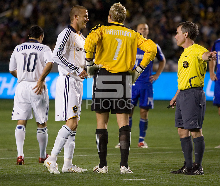LA Galaxy midfielder/captain David Beckham (23) discusses the ensuing penalty kick with Kansas City Wizards goalkeeper Kevin Hartman (1) and referee Michael Kennedy during the second half of a MLS match. The LA Galaxy defeated the Kansas City Wizards 3-1 at Home Depot Center stadium in Carson, Calif., on Saturday, May 24, 2008.