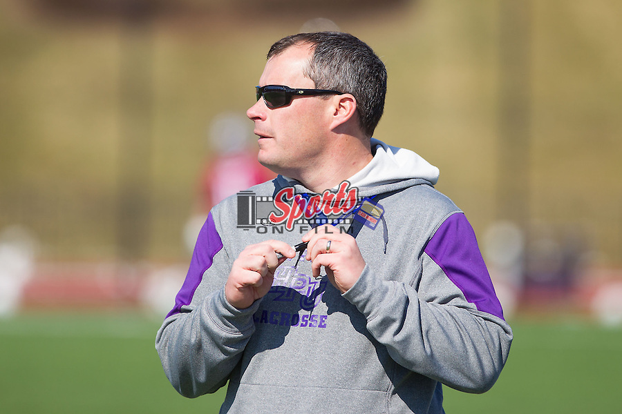 High Point Panthers head coach Jon Torpey watches from the sideline during the match against the St. Joseph's Hawks at Vert Track, Soccer & Lacrosse Stadium on February 16, 2014 in High Point, North Carolina.  The Panthers defeated the Hawks 9-7.   (Brian Westerholt/Sports On Film)