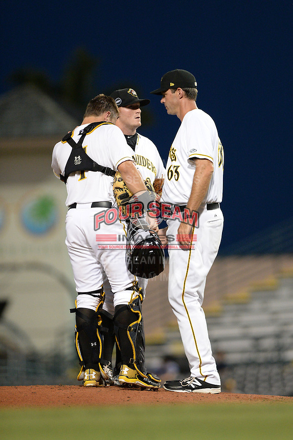 Bradenton Marauders pitching coach Scott Elarton (63) talks with pitcher Brett McKinney (28) and catcher Reese McGuire (7) during a game against the Jupiter Hammerheads on April 18, 2015 at McKechnie Field in Bradenton, Florida.  Bradenton defeated Jupiter 4-1.  (Mike Janes/Four Seam Images)