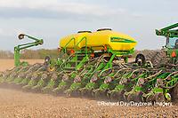 63801-09919 Farmer planting corn Marion Co. IL