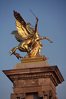 "Gilt-bronze statue of ""Fame"" supported on massives 17 meter socles, Pont Alexandre III, 1896-1900 for World Expo 1900 to commemorate the French-Russian Alliance of 1892, by the architects J. Cassine-Bernard and G. Cousin and engineers A. Alby and J. Resal, 8th arrondissement, Paris, France Picture by Manuel Cohen"