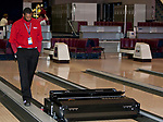 Lane crew team member Tyrone Burks watches the $30,000 Kegel Kustodian Walker machine clean and oil the lanes before the start of the US Bowling Championships on March 1, 2013 at the National Bowling Center in Reno, Nevada.
